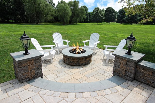 Paver patio with Techo bloc columns and fire pit