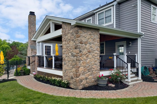 Berghuis - mocha, pecan, and tigerwood Timbertech deck with porch with stone work